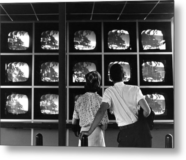 Couple Watching Televisions At New York Metal Print