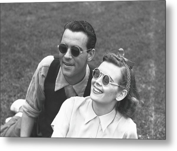 Couple Wearing Sunglasses Sitting On Metal Print by George Marks