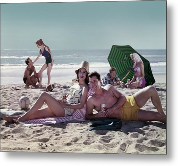 Couples On The Beach Metal Print by Tom Kelley Archive
