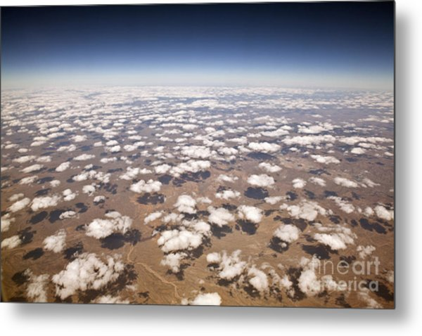 Decorative Clouds Over The Arid Deserts Metal Print