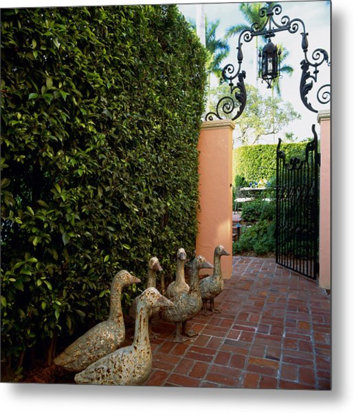 Duck Sculptures At Garden Gate, Palm Metal Print