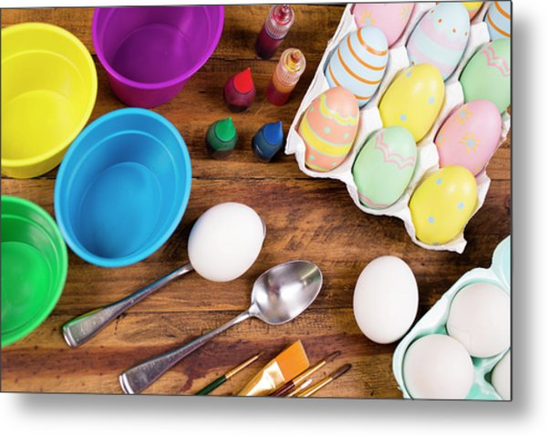 Easter Eggs Being Decorated On Wooden Metal Print by Fstop123