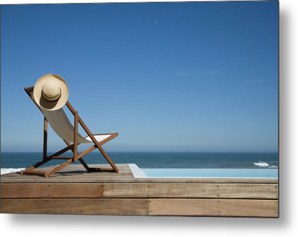 Empty Deck Chair Near Swimming Pool Metal Print
