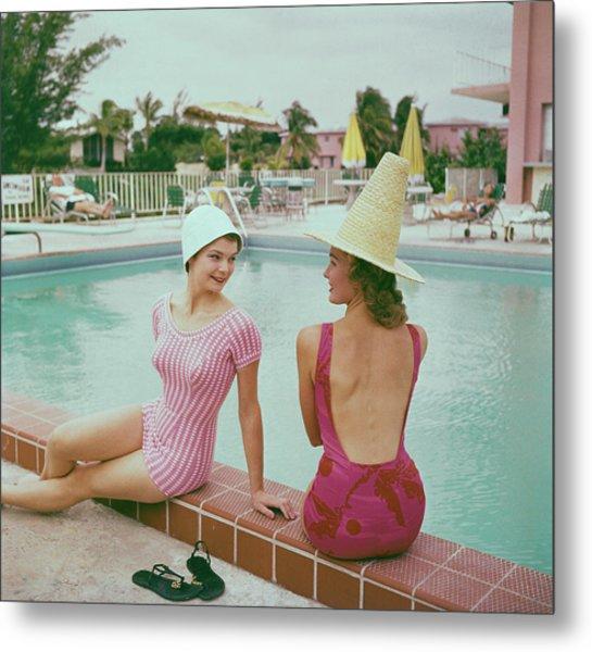 Fashionable Women Lounging At Poolside Metal Print