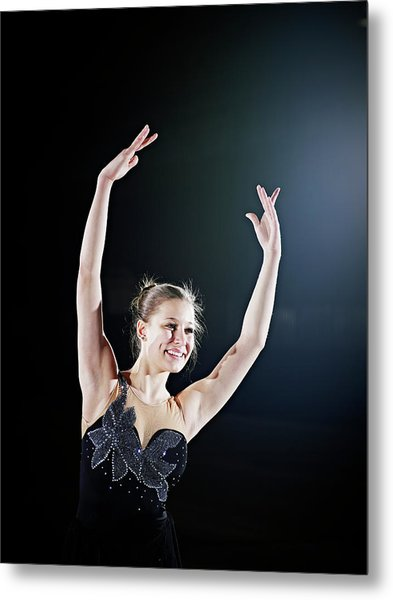 Female Figure Skater Posing With Arms Metal Print by Thomas Barwick