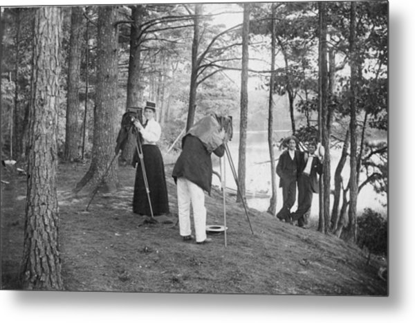 Female Photographer Adusts Her Camera Metal Print by Hulton Archive