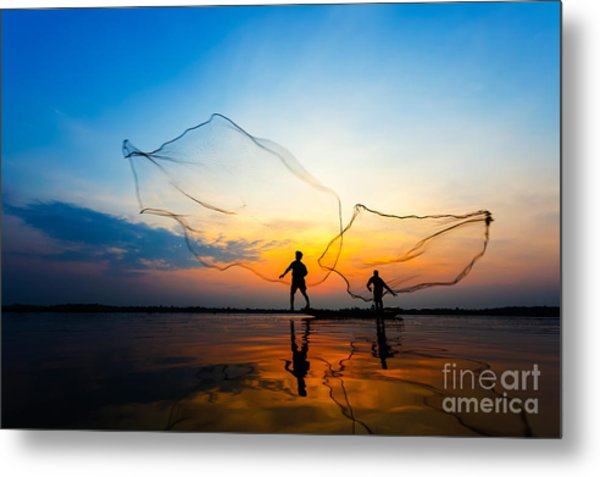 Fishermans In Action When Fishing At Metal Print by Twstock