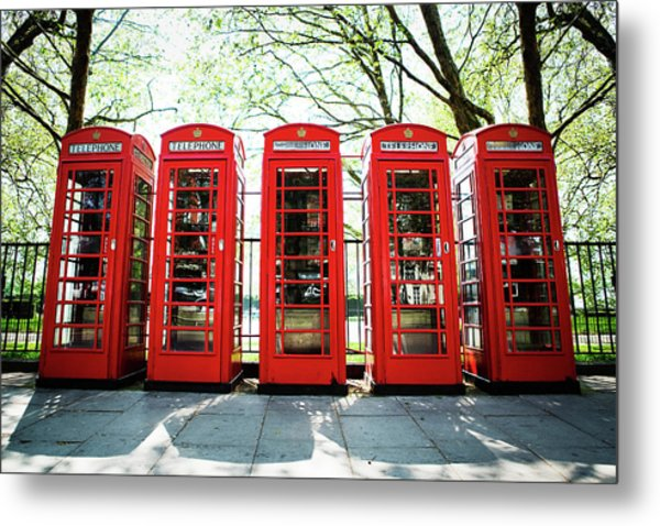 Five Red Telephone Boxes In A Line Metal Print