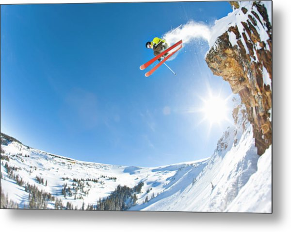 Freestyle Skier Jumping Off Cliff Metal Print