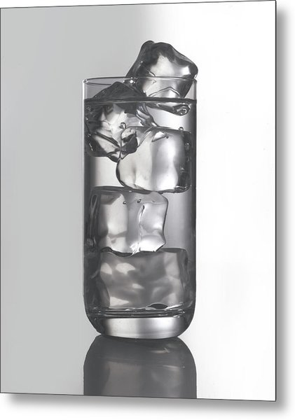 Glass Filled With Water And Ice Metal Print by Tom Kelley