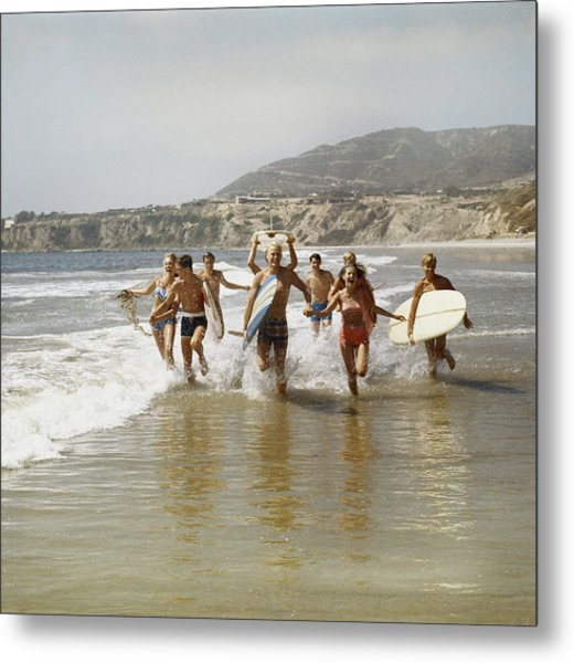 Group Of Surfers Running In Water With Metal Print