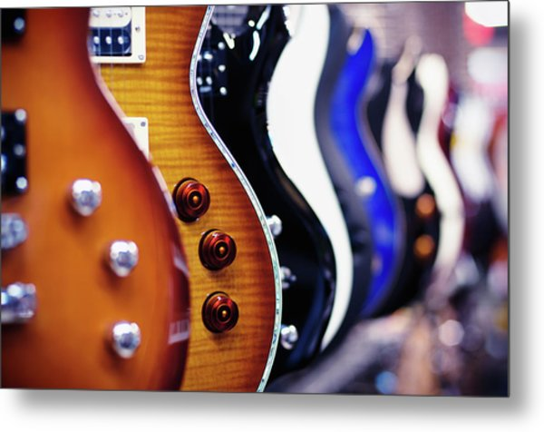 Guitars In A Shop Metal Print