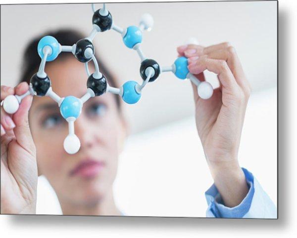 Hispanic Scientist Examining Molecular Metal Print by Jgi/tom Grill