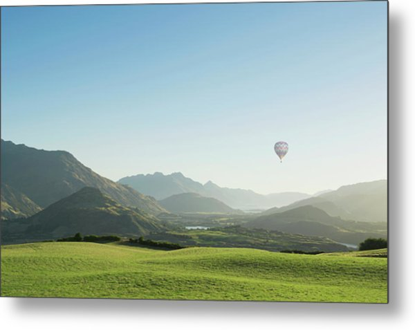 Hot Air Balloon Flying Above Rolling Metal Print by Jacobs Stock Photography Ltd