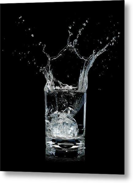 Ice Splashing Into Water Glass Metal Print by Chris Stein
