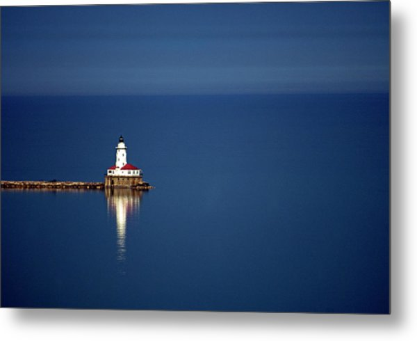 Lighthouse On A Lake Metal Print by By Ken Ilio
