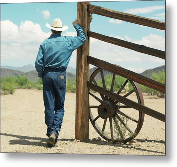 Man Leaning Against Ranch Fence Metal Print