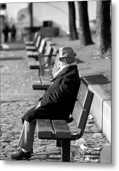 Man Sitting On A Park Bench Soaking Up Metal Print