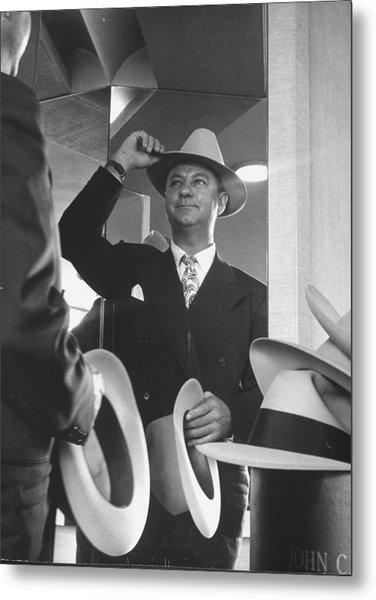 Man Trying On Hats At Nieman Marcus Depa Metal Print by Nina Leen