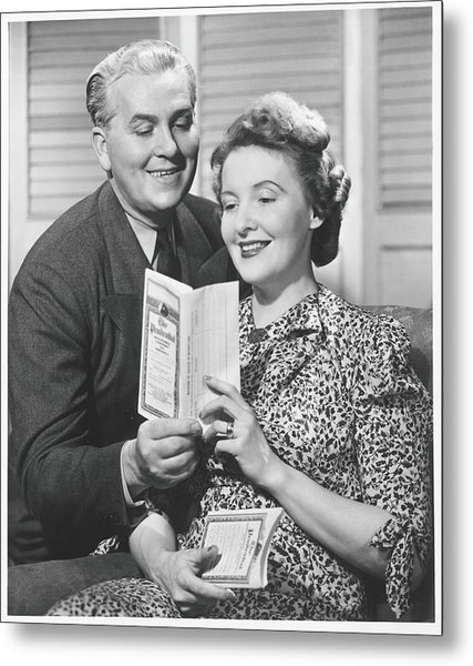 Mature Couple Looking At Brochure, B&w Metal Print