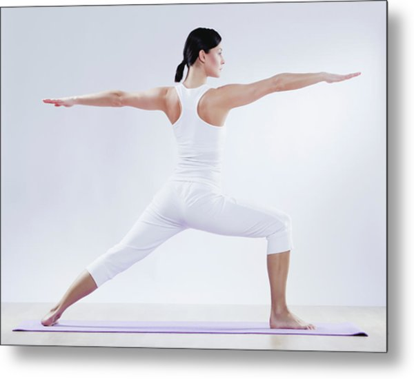 Mid Adult Woman Doing Yoga Against Metal Print by Westend61