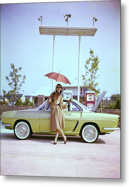 Model In Front Of A Gold Renault Caravelle Metal Print by Jerry Schatzberg
