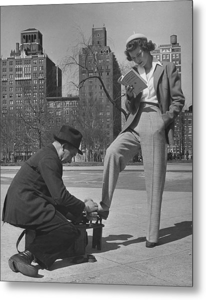 Model Showing Off Slacks As She Reads A Metal Print by Nina Leen