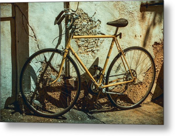 Old Bike Against And Old Wall Metal Print