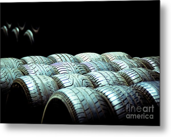 Old Tires And Racing Wheels Stacked In The Sun Metal Print