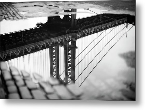 Reflection Of Bridge In Puddle Metal Print