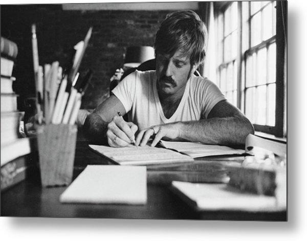 Robert Redford Writing At Desk Metal Print by John Dominis