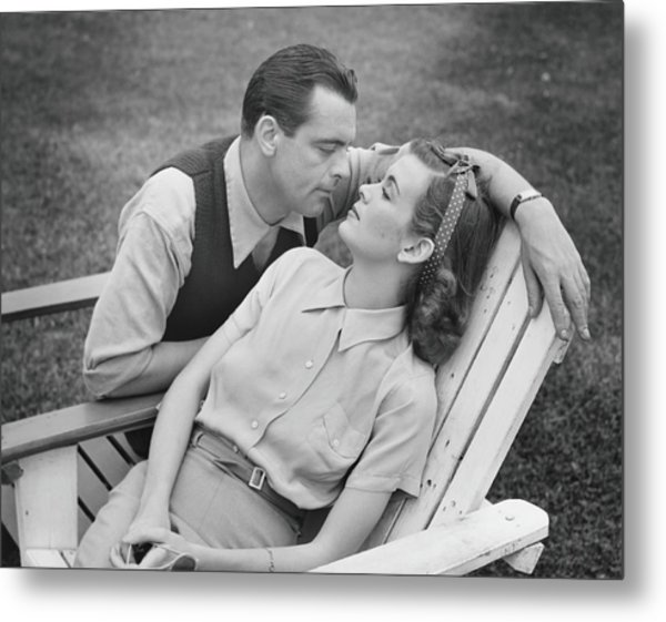 Romantic Couple Relaxing On Deckchair Metal Print