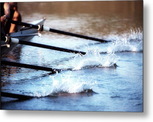 Sculling Team Rowing On Water Metal Print