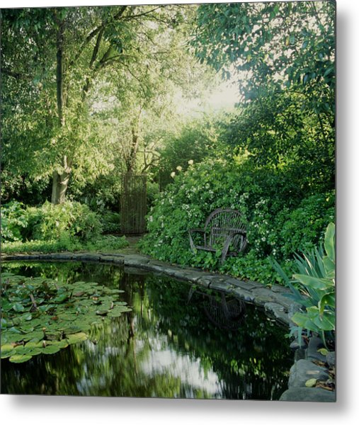 Secluded Garden Pond With Sunlight And Metal Print
