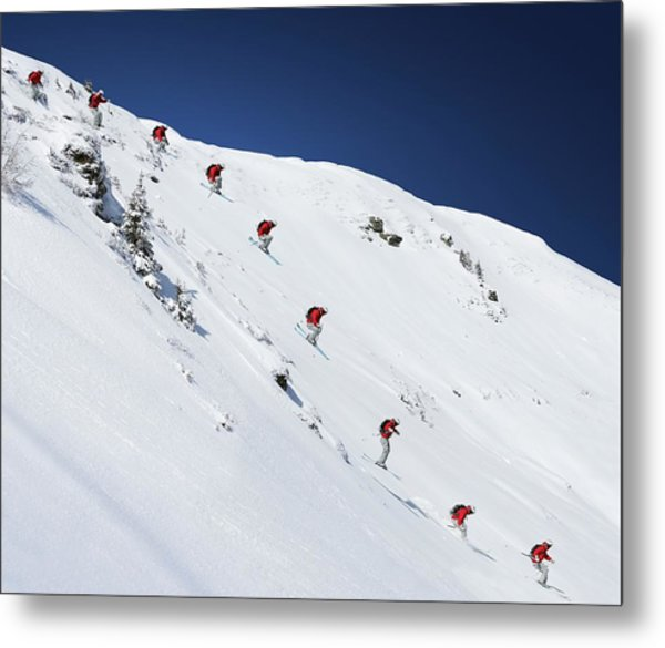 Sequence Of Male Skier Jumping Down Metal Print