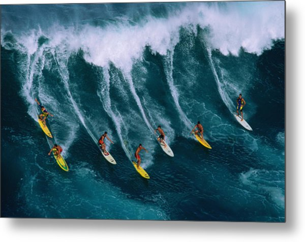 Seven Surfers Riding Large Wave Metal Print