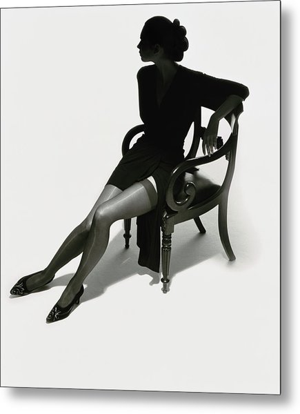 Silhouetted Woman On Chair Metal Print