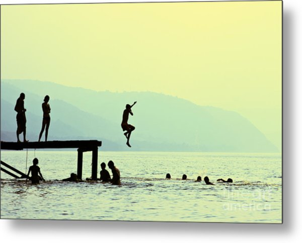 Silhouettes Of Kids Who Jump Off Dock Metal Print