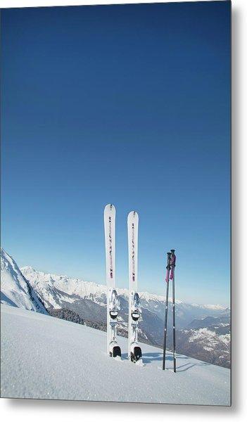 Skis And Ski Poles Stuck In The Snow Metal Print