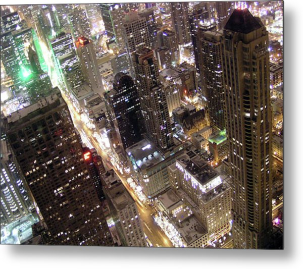 Skyscrapers Illuminated At Night Metal Print by By Ken Ilio