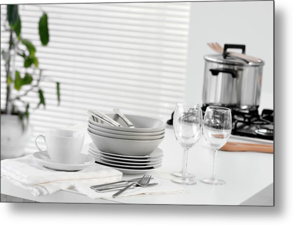 Stacked Dishes And Cutlery On Table Metal Print by Walter Zerla