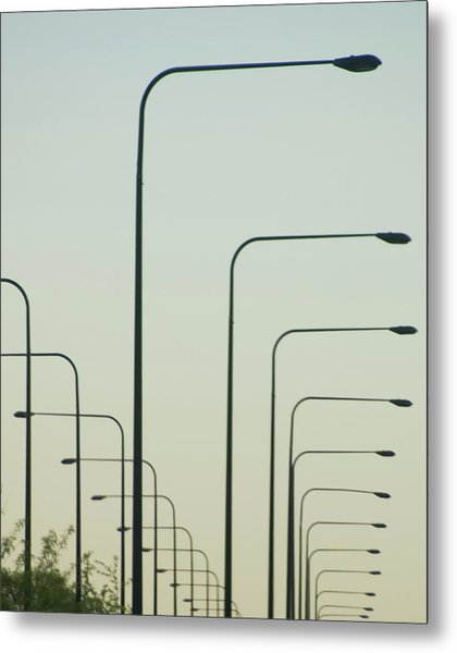 Streetlights Against Afternoon Sky Metal Print by By Ken Ilio