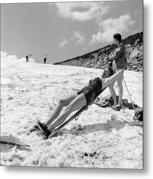 Sunbathing Skier Metal Print by Don