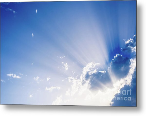 Sunbeams Rising From A Large Cloud In Intense Blue Sky On A Summer Afternoon Metal Print