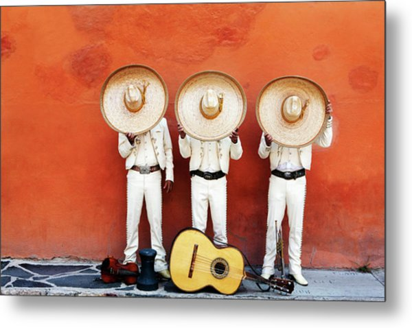 Three Mariachis On An Orange Wall Metal Print