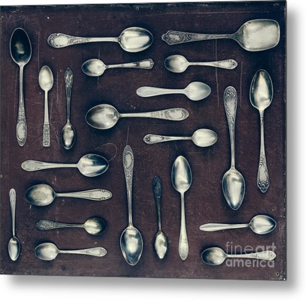 Vintage Set Of Dessert Spoons On A Dark Metal Print