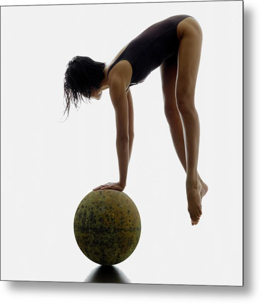 Woman Balancing On Globe Metal Print by Alfonse Pagano