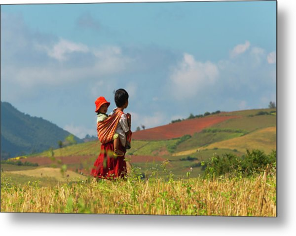Woman Carrying Baby In The Mountain Metal Print