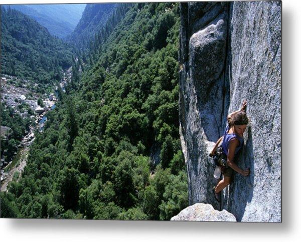Woman Rock Climbing High Above River Metal Print by Heath Korvola
