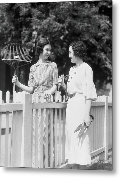 Women Chatting Over Fence Metal Print by H. Armstrong Roberts